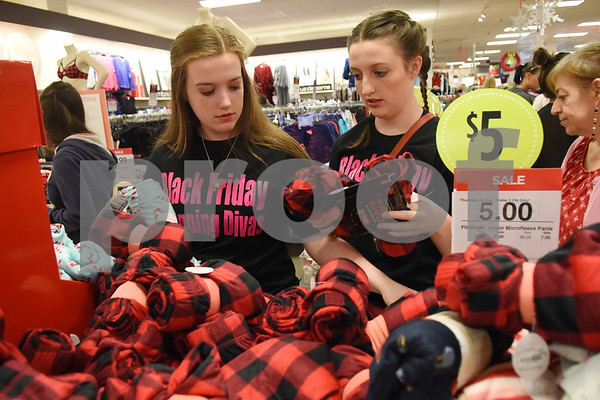 Customers Keslie Cook and Kylie Cook of Lindale shop for pajama pants during the 3 p.m. Black Friday sale opening at the JC Penney department store at Broadway Square Mall in Tyler Thursday Nov. 24, 2016.  (Sarah A. Miller/Tyler Morning Telegraph)