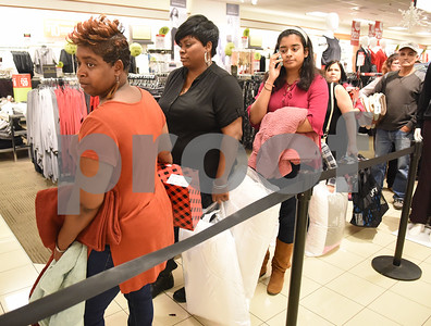 Customers wait at the check out line for the 3 p.m. Black Friday sale opening at the JC Penney department store at Broadway Square Mall in Tyler Thursday Nov. 24, 2016.  (Sarah A. Miller/Tyler Morning Telegraph)