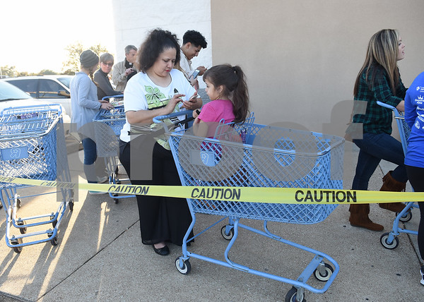 Sandra Garcia and her daughter Desiree, 5, of Tyler, wait in line up to shop at Toys R Us at their 5 p.m. opening for Black Friday sales Thursday Nov. 24, 2016 in Tyler.  (Sarah A. Miller/Tyler Morning Telegraph)