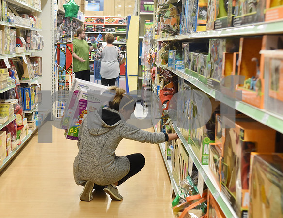 Elisabeth Ayuv of Tyler shops at Toys R Us right at their 5 p.m. opening for Black Friday sales Thursday Nov. 24, 2016 in Tyler.  (Sarah A. Miller/Tyler Morning Telegraph)