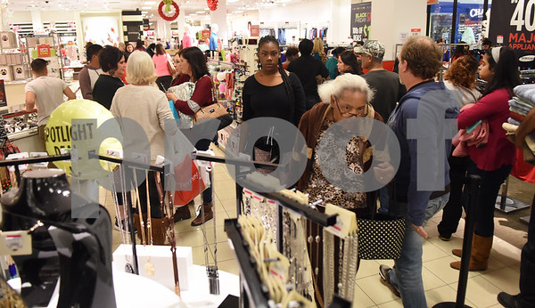 Customers shop just after the 3 p.m. Black Friday sale opening at the JC Penney department store at Broadway Square Mall in Tyler Thursday Nov. 24, 2016.  (Sarah A. Miller/Tyler Morning Telegraph)