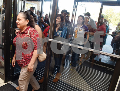 Customers walk in the door for the 3 p.m. Black Friday sale opening at the JC Penney department store at Broadway Square Mall in Tyler Thursday Nov. 24, 2016.  (Sarah A. Miller/Tyler Morning Telegraph)