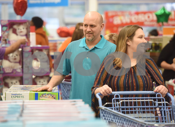 Donell and April Jinkins of Nacogdoches shop at Toys R Us right at their 5 p.m. opening for Black Friday sales Thursday Nov. 24, 2016 in Tyler.  (Sarah A. Miller/Tyler Morning Telegraph)