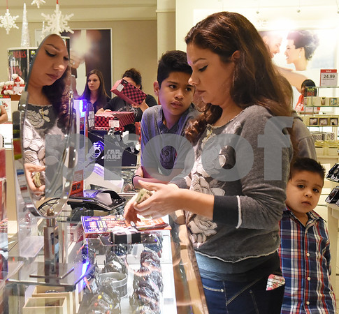 Customer Lolis Saucedo of Tyler makes a purchase at the jewelry counter during the 3 p.m. Black Friday sale opening at the JC Penney department store at Broadway Square Mall in Tyler Thursday Nov. 24, 2016.  (Sarah A. Miller/Tyler Morning Telegraph)