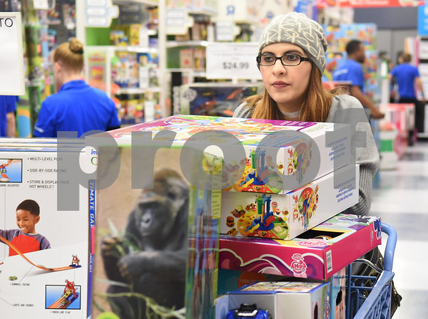 Rebekah Cummins of Tyler shops at Toys R Us right at their 5 p.m. opening for Black Friday sales Thursday Nov. 24, 2016 in Tyler.  (Sarah A. Miller/Tyler Morning Telegraph)