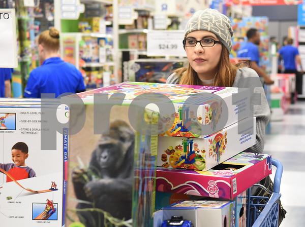 Rebekah Cummins of Tyler shops at Toys R Us right at their 5 p.m. opening for Black Friday sales Thursday Nov. 24, 2016 in Tyler.  (Sarah A. Miller/Tyler Morning Telegraph)