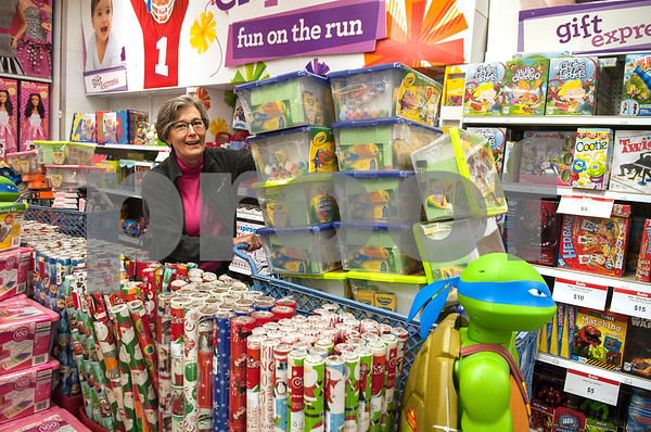 Tricia Jackson fills her shopping cart with bargain priced toys from Toys R Us to donate to a local charity during Black Friday sales on Thanksgiving Day Thursday Nov. 26, 2015 in Tyler, Texas. Toys R Us opened at 5 p.m. Jackson said the toys are collected through the Order of Christian Workers and will benefit 610 East Texas children.  (Sarah A. Miller/Tyler Morning Telegraph)