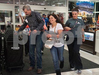 The first customers at Kohl's run inside to start shopping as doors opened at 6 p.m. for Black Friday sales on Thanksgiving Day Thursday Nov. 26, 2015 in Tyler, Texas.   (Sarah A. Miller/Tyler Morning Telegraph)