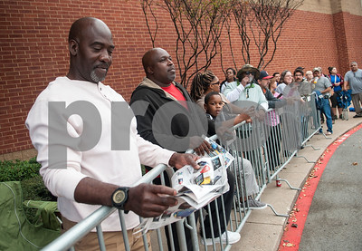 "Keith Jackson of Rusk looks at a sale ad as he waits in line for Best Buy to open for Black Friday sales on Thanksgiving Day Thursday Nov. 26, 2015 in Tyler, Texas. ""I'm prepared to spend $1,000,"" Jackson said.  (Sarah A. Miller/Tyler Morning Telegraph)"
