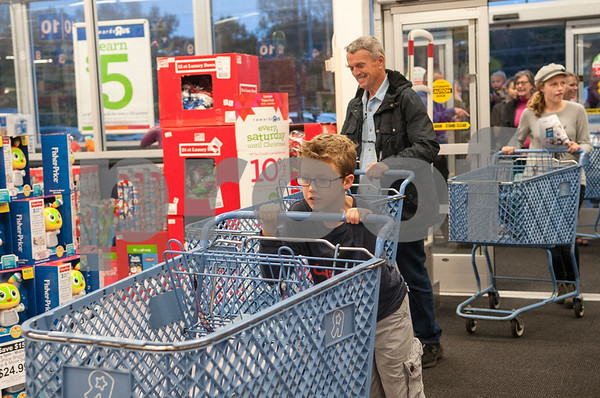 Jackson Shull, 10, shops with his grandfather Father Tom Jackson at Toys R Us during Black Friday sales on Thanksgiving Day Thursday Nov. 26, 2015 in Tyler, Texas. Toys R Us opened at 5 p.m.   (Sarah A. Miller/Tyler Morning Telegraph)