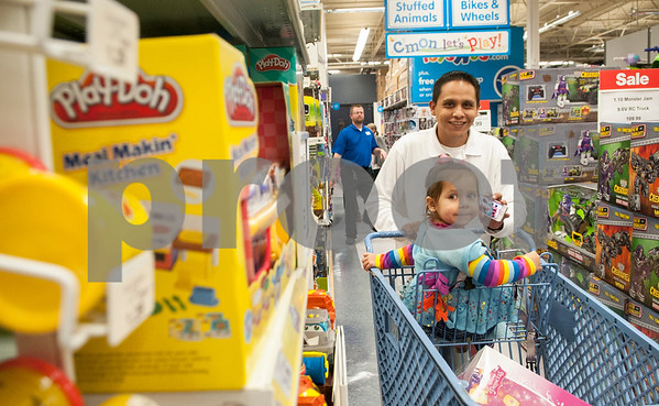 Jacob Guzman of Tyler shops with his daughter Cesiley Guzman, 3, at Toys R Us during Black Friday sales on Thanksgiving Day Thursday Nov. 26, 2015 in Tyler, Texas. Toys R Us opened at 5 p.m.   (Sarah A. Miller/Tyler Morning Telegraph)