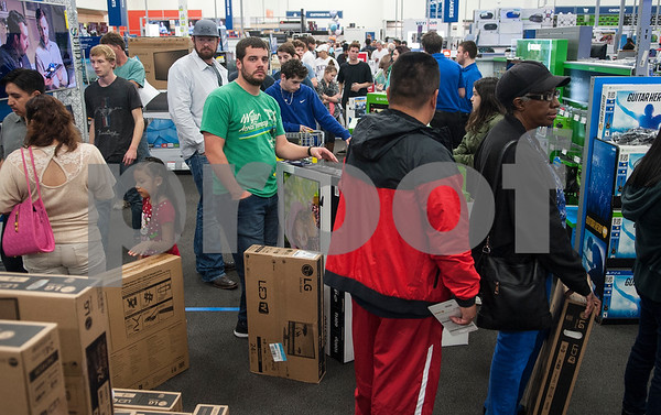 Customers at Best Buy form a huge checkout line around the store during Black Friday sales on Thanksgiving Day Thursday Nov. 26, 2015 in Tyler, Texas. Best Buy opened at 5 p.m. Many shoppers were hoping to buy televisions.   (Sarah A. Miller/Tyler Morning Telegraph)