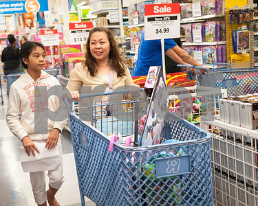 Arielle Gustilo, 9, of Tyler shops at Toys R Us with her mother Sarrah Gustily during Black Friday sales on Thanksgiving Day Thursday Nov. 26, 2015 in Tyler, Texas. Toys R Us opened at 5 p.m.   (Sarah A. Miller/Tyler Morning Telegraph)