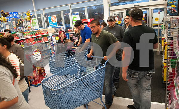 The first shoppers come through the doors at Toys R Us during Black Friday sales on Thanksgiving Day Thursday Nov. 26, 2015 in Tyler, Texas. Toys R Us opened at 5 p.m.   (Sarah A. Miller/Tyler Morning Telegraph)