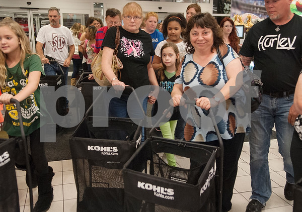 Shoppers rush in the door to take advantage of Black Friday sales on Thanksgiving Day at Kohl's Thursday Nov. 26, 2015 in Tyler, Texas.   (Sarah A. Miller/Tyler Morning Telegraph)