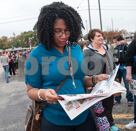 Ty Beverly of Tyler looks at a sale ad as she waits in line for Toys R Us to open during Black Friday sales on Thanksgiving Day Thursday Nov. 26, 2015 in Tyler, Texas. Toys R Us opened at 5 p.m.   (Sarah A. Miller/Tyler Morning Telegraph)