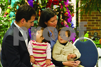 Photo by Shannon Wilson/Staff  One year old Daniela Guzzetta sits with her parents, Joe and Carolina Guzzetta, and her brother during the announcement that she has been selected to represent the Children's Miracle Network during this holiday season.