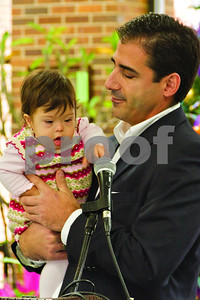Photo by Shannon Wilson/Staff  Joe Guzzetta holds his one year old daughter, Daniela.  Daniela has been selected to represent the Children's Miracle Network during this holiday season.