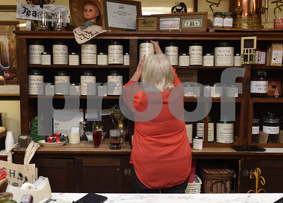 Owner Lola May puts a tin of loose leaf tea back on the shelf The Screen Door Antique Mall in Gladewater Wednesday Dec. 28, 2016. The antique shop sells hot and cold teas as well as coffee with a seating area and free wifi.   (Sarah A. Miller/Tyler Morning Telegraph)