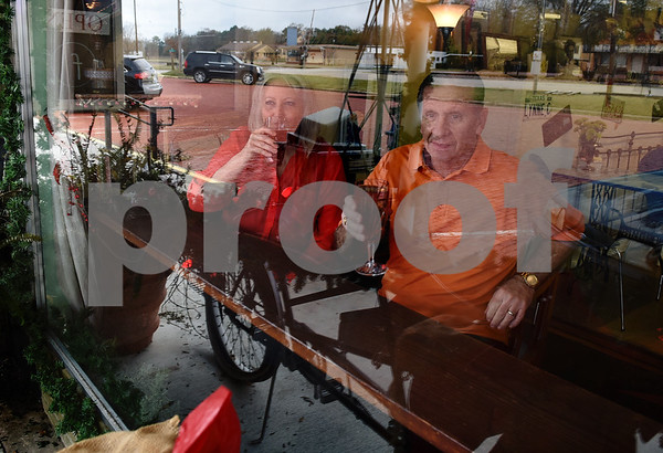 Owners Lola and Mark May sip hot teas poured over ice in the window front of their store The Screen Door Antique Mall in Gladewater Wednesday Dec. 28, 2016. The couple sells hot and cold teas as well as coffee inside their shop.  (Sarah A. Miller/Tyler Morning Telegraph)