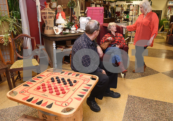 Fellow shop owners Don and Jan Greenwood visits The Screen Door Antique Mall owner Lola May at her store in Gladewater Wednesday Dec. 28, 2016. The antique shop sells hot and cold teas as well as coffee with a seating area and free wifi.   (Sarah A. Miller/Tyler Morning Telegraph)