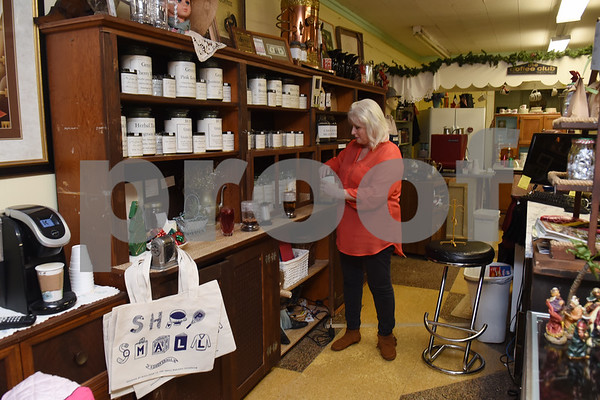 Owner Lola May makes a hot tea at her store The Screen Door Antique Mall in Gladewater Wednesday Dec. 28, 2016. The antique shop sells hot and cold teas as well as coffee with a seating area and free wifi.   (Sarah A. Miller/Tyler Morning Telegraph)