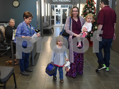 Kara Marrs of Hawkins drops her daughters Lillian, 3, and Abby, 1, at Mother's Day Out, a drop-in day care, Tuesday Nov. 29, 2016 at First Christian Church in Tyler. The program in open for children age 0-6 Monday through Friday.  (Sarah A. Miller/Tyler Morning Telegraph)