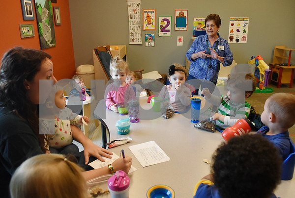 Carolyn Wallace, director of Mother's Day Out, sings a nursery rhyme with children at her drop-in day care Tuesday Nov. 29, 2016 at First Christian Church in Tyler. The program in open for children age 0-6 Monday through Friday.  (Sarah A. Miller/Tyler Morning Telegraph)