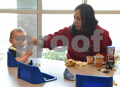 Ying Ying Yang feeds infant Asher Williams at Mother's Day Out, a drop-in day care, Tuesday Nov. 29, 2016 at First Christian Church in Tyler. The program in open for children age 0-6 Monday through Friday.  (Sarah A. Miller/Tyler Morning Telegraph)