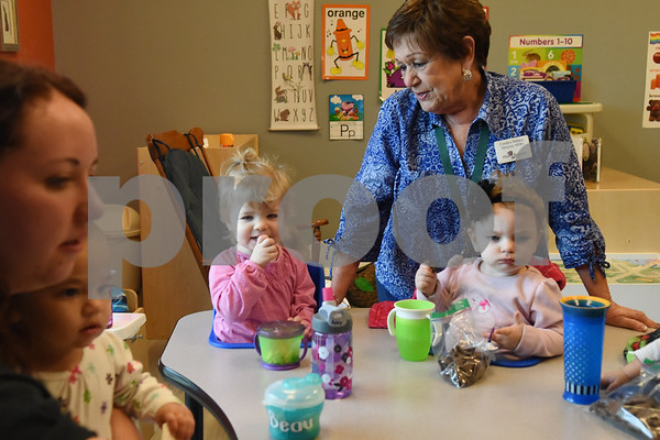 Carolyn Wallace, director of Mother's Day Out, visits with children at her drop-in day care Tuesday Nov. 29, 2016 at First Christian Church in Tyler. The program in open for children age 0-6 Monday through Friday.  (Sarah A. Miller/Tyler Morning Telegraph)