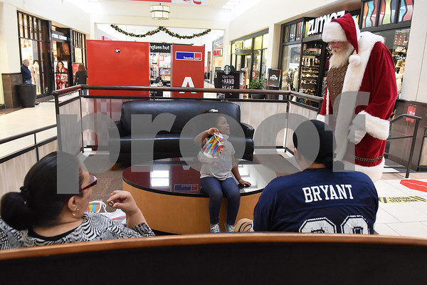 Santa Claus greets Sianna Alvarado, 3, at Broadway Square Mall in Tyler Tuesday Nov. 29, 2016.  (Sarah A. Miller/Tyler Morning Telegraph)