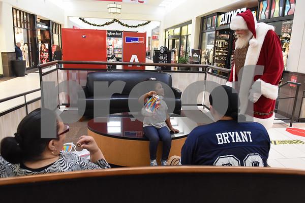 Santa Claus greets Sianna Alvarado, 3, at Broadway Square Mall in Tyler Tuesday Nov. 29, 2016.  (Sarah A. Miller/Tyler Morning Telegraph)