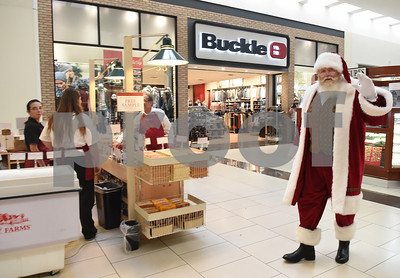 Santa Claus walks past the Hickory Farms kiosk at Broadway Square Mall in Tyler Tuesday Nov. 29, 2016.  (Sarah A. Miller/Tyler Morning Telegraph)