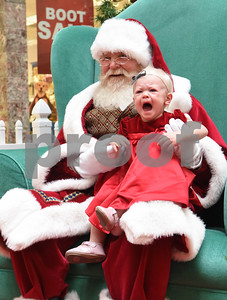 Annakate Bynum, 1, has her photo taken with Santa Claus at Broadway Square Mall in Tyler Tuesday Nov. 29, 2016.  (Sarah A. Miller/Tyler Morning Telegraph)