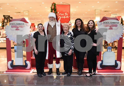 Santa Claus takes a photo with Dillard employees at Broadway Square Mall in Tyler Tuesday Nov. 29, 2016. Pictured from left: Haley Fontenot, Melba Mebane, Stephanie Rose and Sydney Grimes.  (Sarah A. Miller/Tyler Morning Telegraph)