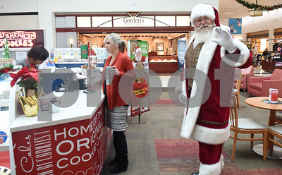 Santa Claus waits in line for a cookie at Broadway Square Mall in Tyler Tuesday Nov. 29, 2016.   (Sarah A. Miller/Tyler Morning Telegraph)