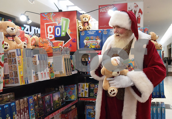 Santa Claus shops for toys at a kiosk at Broadway Square Mall in Tyler Tuesday Nov. 29, 2016.   (Sarah A. Miller/Tyler Morning Telegraph)
