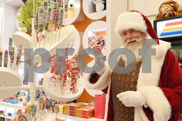 Santa Claus enjoys a candy cane lollipop at Broadway Square Mall in Tyler Tuesday Nov. 29, 2016.  (Sarah A. Miller/Tyler Morning Telegraph)