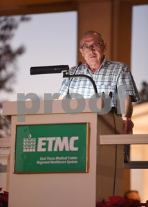 Norman Frazier, a paramedic with ETMC EMS in Collin County, speaks about PTSD before lighting the new living Christmas tree at East Texas Medical Center Tyler during the 29th annual Christmas tree lighting Tuesday, Nov. 29, 2016.  (Sarah A. Miller/Tyler Morning Telegraph)