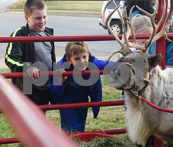Caydence Brown, 12, and Levi McGee, 9, of Troup, look at a reindeer during the 29th annual East Texas Medical Center Tyler  Christmas tree lighting Tuesday, Nov. 29, 2016.  (Sarah A. Miller/Tyler Morning Telegraph)