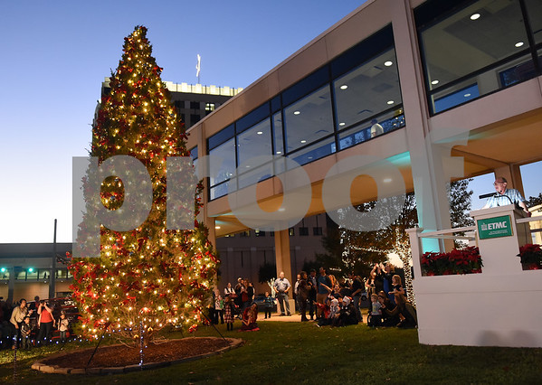 Norman Frazier, a paramedic with ETMC EMS in Collin County, lights  the new living Christmas tree at East Texas Medical Center Tyler during the 29th annual Christmas tree lighting Tuesday, Nov. 29, 2016.  (Sarah A. Miller/Tyler Morning Telegraph)