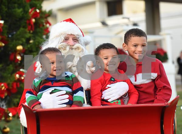 Santa Claus takes a photo with Jace Davis, Jackson Davis, 3, and Jaden Davis, 7, during the 29th annual East Texas Medical Center Tyler  Christmas tree lighting Tuesday, Nov. 29, 2016.  (Sarah A. Miller/Tyler Morning Telegraph)