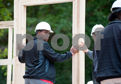 photo by Sarah A. Miller/Tyler Morning Telegraph  Ramontae Monmouth, 16, helps with the construction of his family's future home on N. Spring Ave. in Tyler Monday. Ramontae Monmouth, his sister Naquisha, 18, and mother Cheresa will live in the home, which will be Habitat for Humanity's 100th home to be built in Smith County.