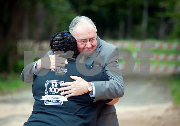 photo by Sarah A. Miller/Tyler Morning Telegraph  Habitat for Humanity of Smith County chief executive director Jack Wilson hugs new homeowner Cheresa Monmouth at the wall raising ceremony for her future home on N. Spring Ave. in Tyler Monday. Monmouth's home is Habitat for Humanity's 100th home to be built in Smith County. Monmouth, a mother of two, will purchase the 100th home with a 30-year no-interest mortgage held by Smith County Habitat. The home will be built in 100 working hours, beginning with the raising of the walls.