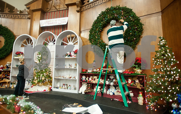 photo by Sarah A. Miller/Tyler Morning Telegraph  Martha Nevarez and Alberto Sustaita put together a Christmas decoration display at The Store at Cornerstone in Tyler Wednesday Nov. 5, 2014. East Texas Cornerstone Assistance Network  provides services to their clients such as rent assistance, vouchers for clothing, assistance finding jobs and counseling.