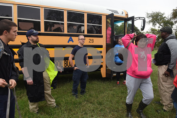 Volunteer Sabrina Garcia, an aunt of Kayla Gomez-Orozco, exits a bus at an area to look for missing child Kayla Gomez-Orozco Saturday morning in Bullard. Hundreds of people gathered at Bullard High School at 7 a.m. to join in the effort to find the missing 10-year-old.  (Sarah A. Miller/Tyler Morning Telegraph)