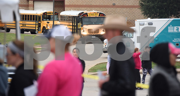 Busses line up to take volunteers to different areas to look for missing child Kayla Gomez-Orozco Saturday morning in Bullard. Hundreds of people gathered at Bullard High School at 7 a.m. to join in the effort to find the missing 10-year-old.  (Sarah A. Miller/Tyler Morning Telegraph)