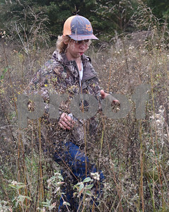 Christian Bullard, 16, of Bullard, walks through tall brush as he looks for missing child Kayla Gomez-Orozco Saturday morning in Bullard. Hundreds of people gathered at Bullard High School at 7 a.m. to join in the effort to find the missing 10-year-old.  (Sarah A. Miller/Tyler Morning Telegraph)