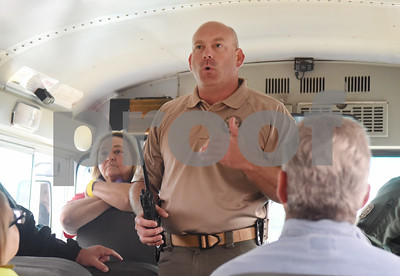 Texas Ranger Brent Davis gives instructions to volunteers on a bus headed to a wooded area to look for missing child Kayla Gomez-Orozco Saturday morning in Bullard. Hundreds of people gathered at Bullard High School at 7 a.m. to join in the effort to find the missing 10-year-old.  (Sarah A. Miller/Tyler Morning Telegraph)