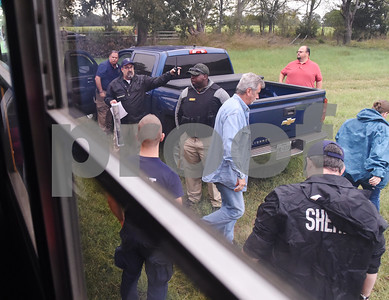 Law enforcement officials give instructions to volunteers as they exit a bus at an area to look for missing child Kayla Gomez-Orozco Saturday morning in Bullard. Hundreds of people gathered at Bullard High School at 7 a.m. to join in the effort to find the missing 10-year-old.  (Sarah A. Miller/Tyler Morning Telegraph)